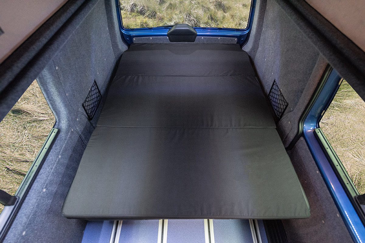 Sleeping arrangement inside b-active VW Campervan Conversion