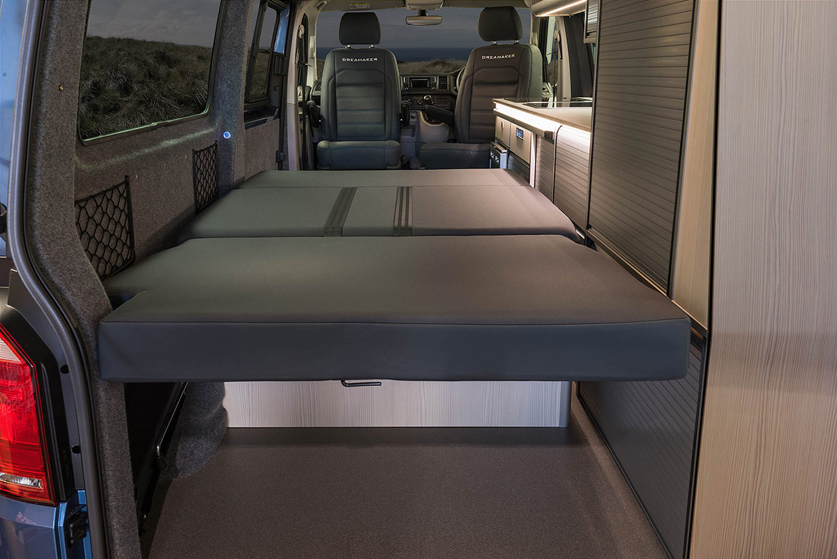 Bed shown  from the rear of the campervan