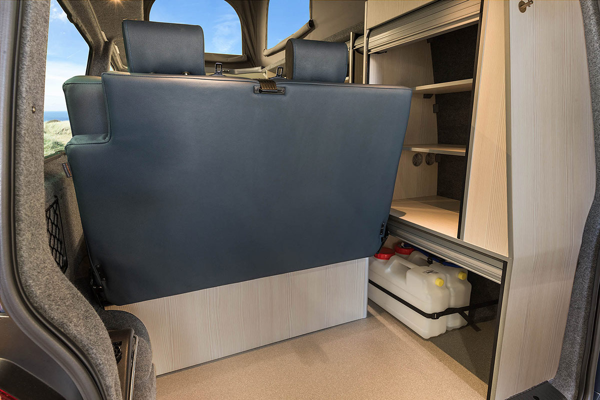 Bed shown in conjunction with storage and cooking facilities