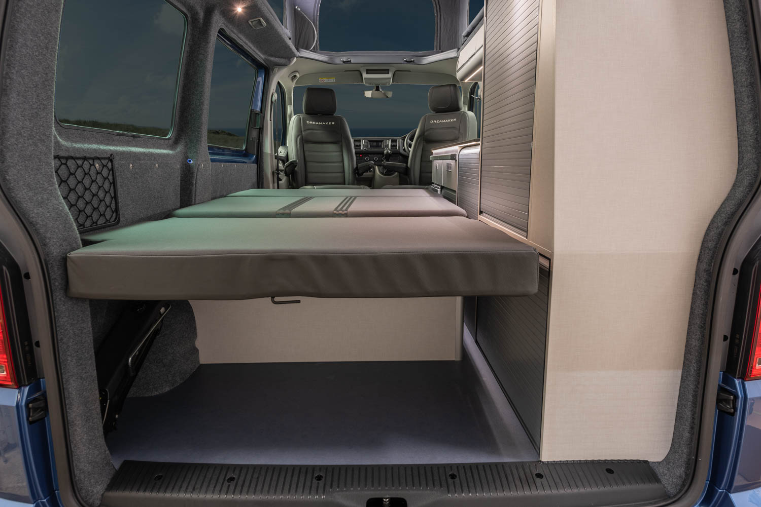 Side view of the table and seating arrangement inside the Dreamaker VW Camper conversion