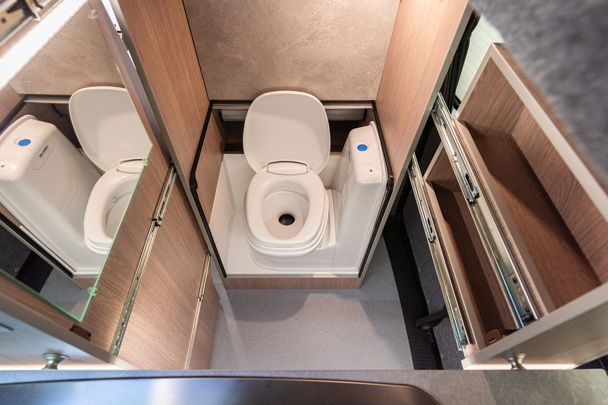 Hidden toilet inside transtourer VW Campervan Conversion
