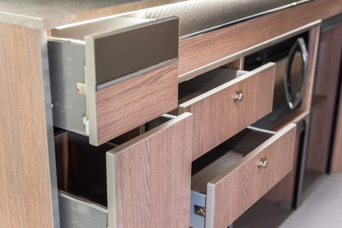 Photo showing close-up of storage cupboards and drawers