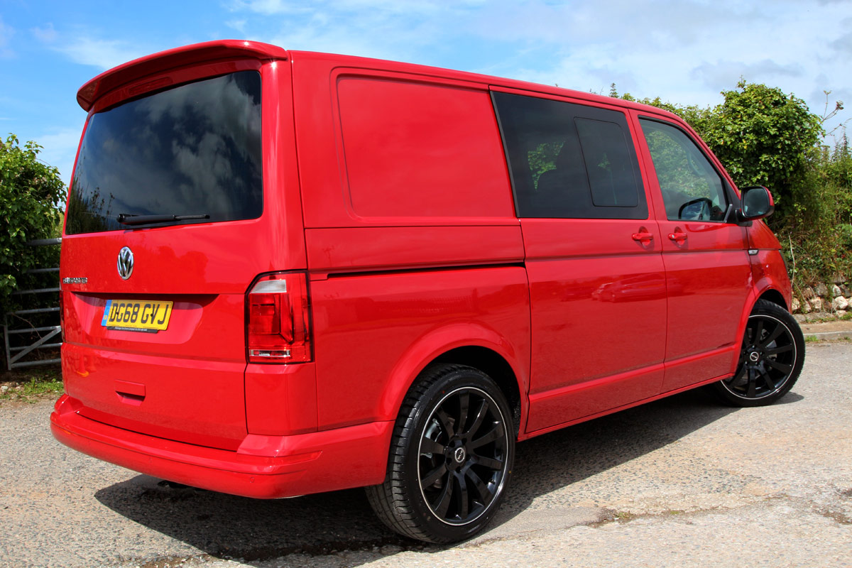 Driver side view of red VW T32 SWB Highline B-Active